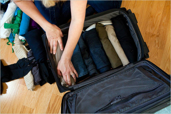 Packed Suitcase - Global Travel Alliance SA